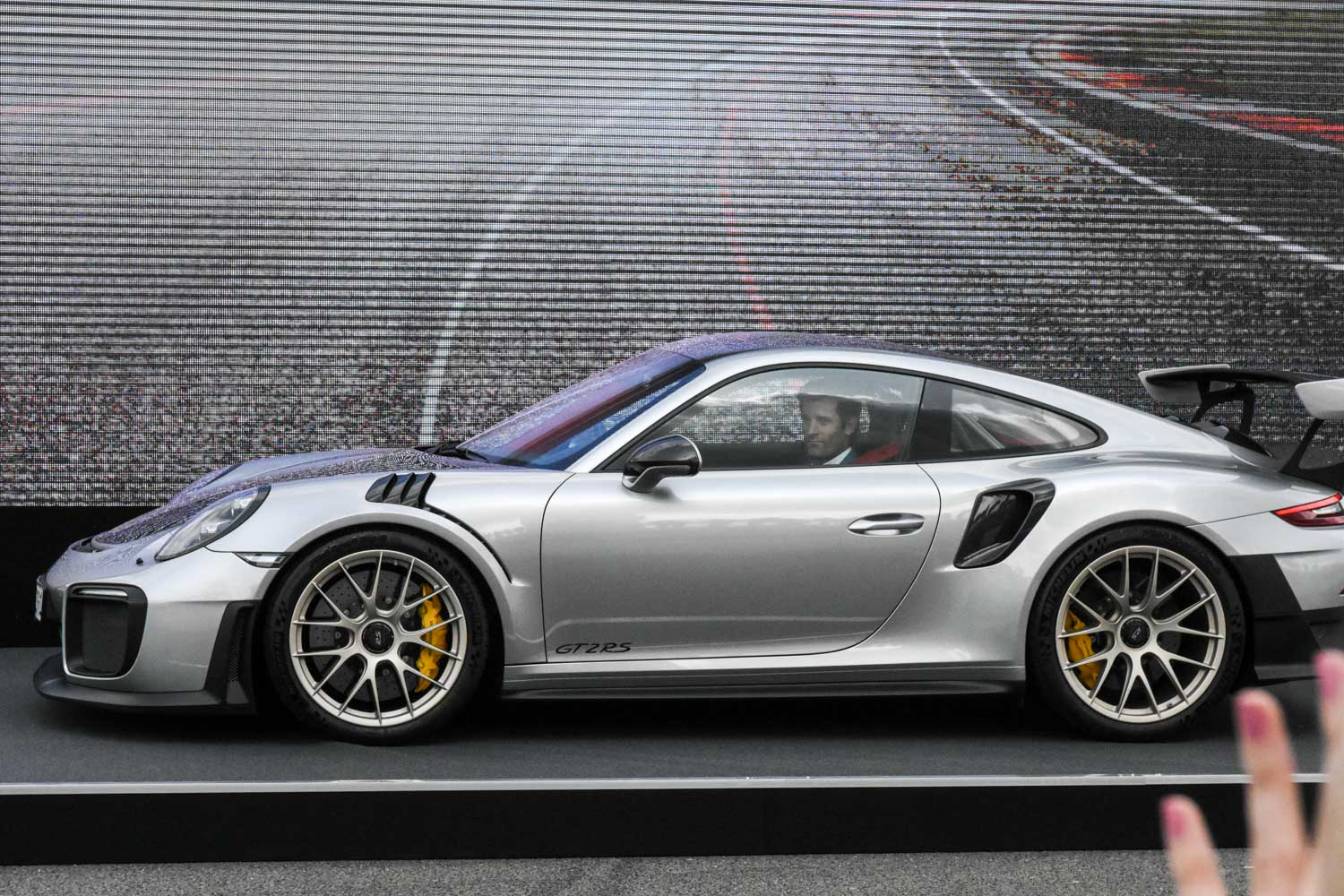 Mark Webber arriving in the new 911 GT2RS